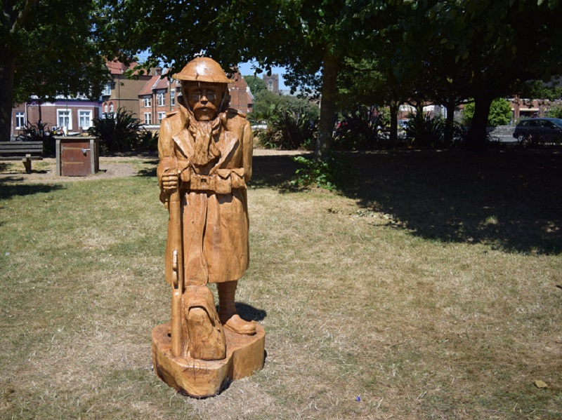 Oak sculpture of a lone soldier, commemorating WW1