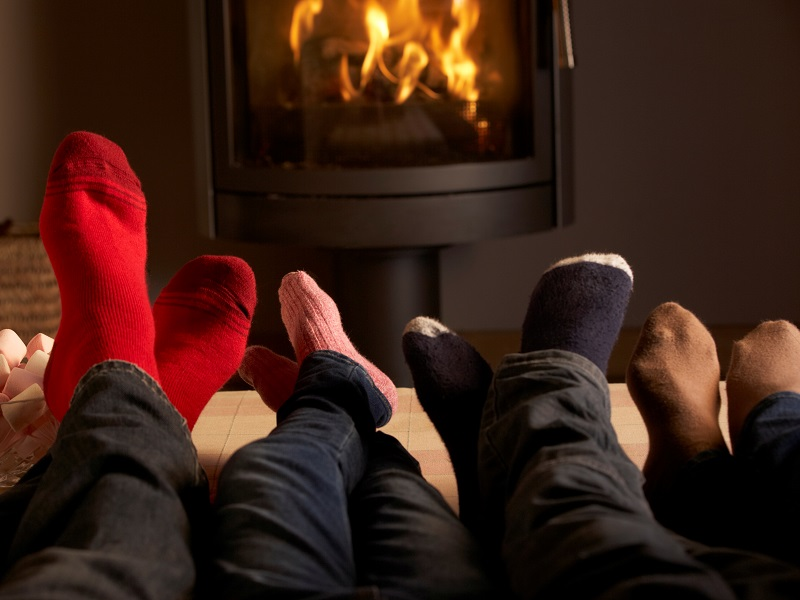 Family in front of a warming fire
